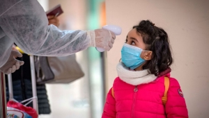Moroccan health workers scan passengers arriving from Italy for coronavirus COVID-19 at Casablanca Mohammed V International Airport on March 3, 2020. (Photo by FADEL SENNA / AFP) (Photo by FADEL SENNA/AFP via Getty Images)