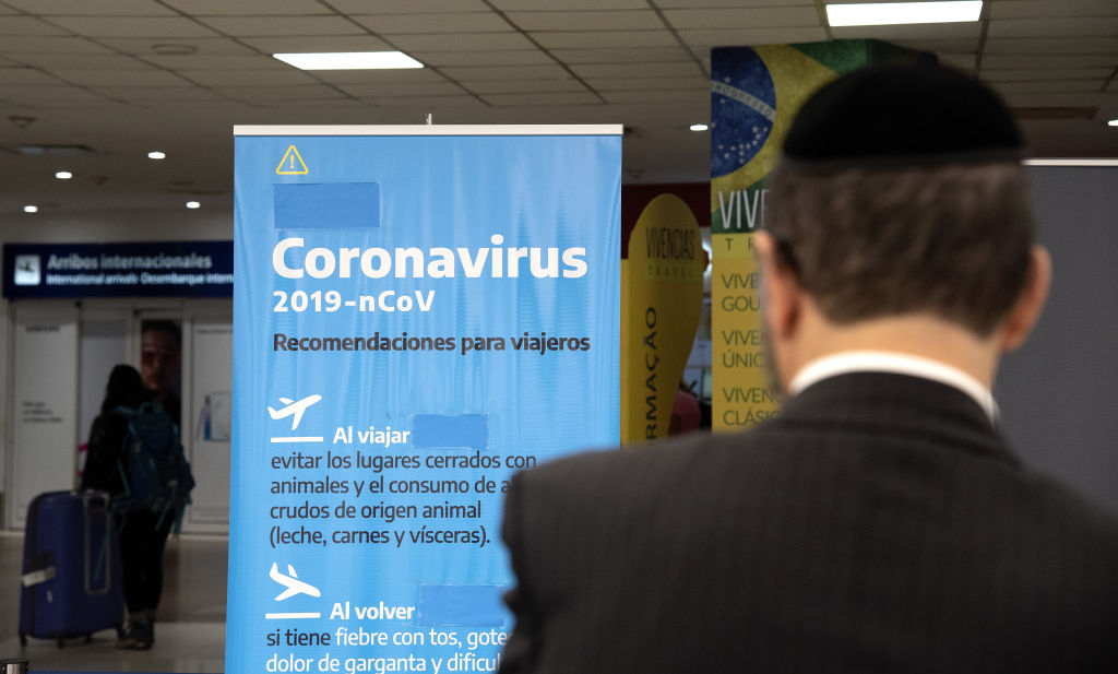 EZEIZA, ARGENTINA - MARCH 13: A banner with precautionary meassures is seen at Ministro Pistarini International Airport on March 13, 2020 in Ezeiza, Argentina. President of Argentina Alberto Fernandez signed a decree to ban travel from areas affected by COVID-19 outbreak. (Photo by Lalo Yasky/Getty Images)