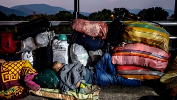 A Venezuelan attempting to return to his country due to the novel coronavirus COVID-19 pandemic, sleeps in the Simon Bolivar International Bridge in Cucuta, Colombia, on April 26, 2020, after the Venezuelan government closed the way to some 300 Venezuelans coming home. (Photo by Schneyder MENDOZA / AFP) (Photo by SCHNEYDER MENDOZA/AFP via Getty Images)