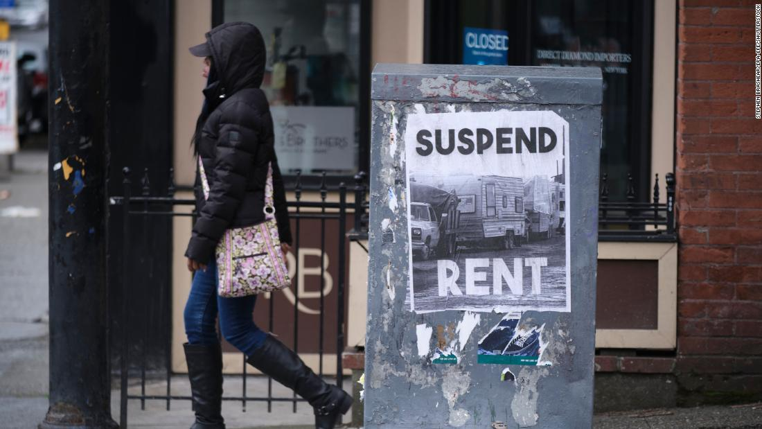 Mandatory Credit: Photo by STEPHEN BRASHEAR/EPA-EFE/Shutterstock (10595051d) A sign calling for the suspension of rent during the COVID-19 outbreak is pictured in downtown Seattle, Washington, USA, 26 March 2020. Unemployment claims in the area have shot up recently as the economy had ground to a halt. Washington State Response to COVID-19, Shoreline, USA - 26 Mar 2020