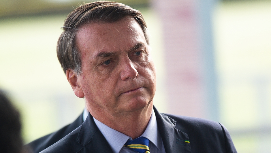 BRASILIA, BRAZIL - MAY 06: President of Brazil Jair Bolsonaro talks to supporters of his government who waited for him outside the Palácio do Alvorada amidst the coronavirus (COVID-19) pandemic on May 06, 2020 in Brasilia. Brazil has over 114,000 confirmed positive cases of Coronavirus and 7,921 deaths. (Photo by Andressa Anholete/Getty Images)