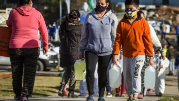 BUENOS AIRES, ARGENTINA - JUNE 03: A boy wearing a face mask walks with a drum of drinking water at Villa 21-24 on June 3, 2020 in Buenos Aires, Argentina. Government-ordered lockdown was extended until June 07 due to increase in the number of positive cases. (Photo by Marcelo Endelli/Getty Images)