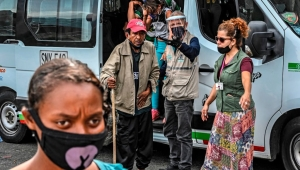 Homeless people get off a van transporting them to an area provided for them to take a shower and eat amid the COVID-19 pandemic in Medellin, Colombia, on June 23, 2020. (Photo by JOAQUIN SARMIENTO / AFP) (Photo by JOAQUIN SARMIENTO/AFP via Getty Images)