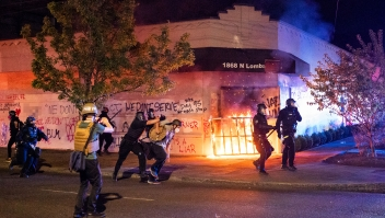 PORTLAND, OR - AUGUST 29: Portland police disperse a crowd after protesters set fire to the Portland Police Association (PPA) building early in the morning on August 29, 2020 in Portland, Oregon. The PPA, a headquarters for the Portland police union, has been a regular target during the 93 days of protests in Portland. (Photo by Nathan Howard/Getty Images)