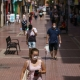 People walk down a shopping street at the Las Delicias neighbourhood of Zaragoza in northeastern Spain on August 10, 2020. - Spain has added 19,405 new coronavirus cases in the past week, but the health ministry says the country is not entering a second wave of the pandemic. (Photo by CESAR MANSO / AFP) (Photo by CESAR MANSO/AFP via Getty Images)