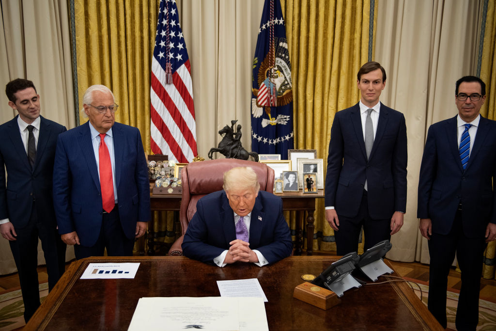 "US Ambassador to Israel David Friedman (2nd L), Senior Advisor Jared Kushner (2nd R), and US Secretary of the Treasury Steven Mnuchin (R) listen as US President Donald Trump announces an agreement between the United Arab Emirates and Israel to normalize diplomatic ties, the White House August 13, 2020, in Washington, DC. - Trump on Thursday made the surprise announcement of a peace agreement between Israel and the United Arab Emirates. The normalization of relations between the UAE and Israel is a ""HUGE breakthrough"" Trump tweeted, calling it a ""Historic Peace Agreement between our two GREAT friends."" (Photo by Brendan Smialowski / AFP) (Photo by BRENDAN SMIALOWSKI/AFP via Getty Images)"