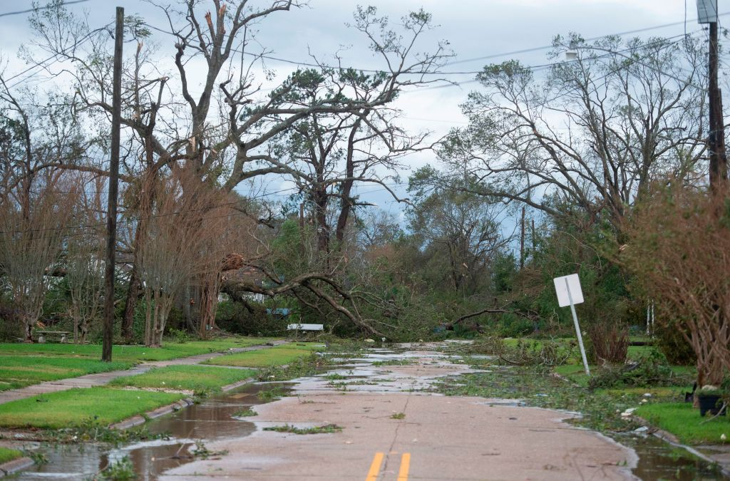 A road is blocked off by destroyed trees after the passing of Hurricane Laura in Lake Charles, Louisiana on August 27, 2020. - Hurricane Laura slammed into the southern US state of Louisiana Thursday and the monster category 4 storm prompted warnings of