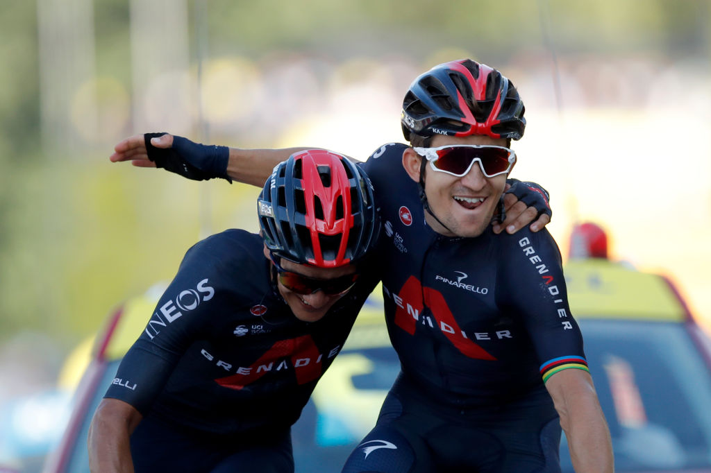Team Ineos rider Poland's Michal Kwiatkowski (R) celebrates as he crosses the finish line ahead of Team Ineos rider Ecuador's Richard Carapaz during the 18th stage of the 107th edition of the Tour de France cycling race, 168 km between Meribel and La Roche sur Foron, on September 17, 2020. (Photo by STEPHANE MAHE / various sources / AFP) (Photo by STEPHANE MAHE/AFP via Getty Images)
