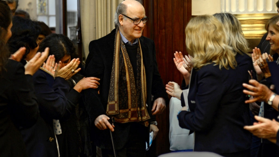"Argentine cartoonist Joaquin Lavado, known by his pen name Quino (C), creator of the famous cartoon strip Mafalda -translated to 15 languages- is applauded during a tribute ceremony for his 80th birthday held at the Argentine Congress in Buenos Aires on August 30, 2012. The cartoonist gained international recognition in 1969 with the European publication of ""Mafalda, la contestataria"" (Mafalda, the rebel"") with a prologue by Italian writer Umberto Eco. AFP PHOTO / DANIEL GARCIA (Photo by DANIEL GARCIA / AFP) (Photo by DANIEL GARCIA/AFP via Getty Images)"