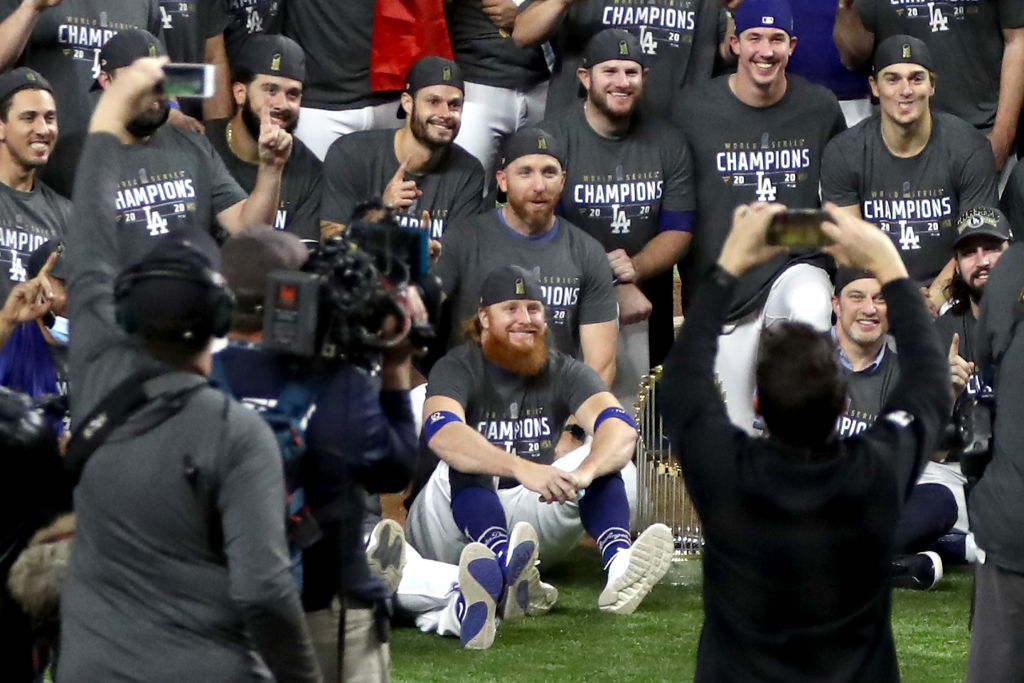 ARLINGTON, TEXAS - OCTOBER 27: Justin Turner #10 and the Los Angeles Dodgers pose for a photo after defeating the Tampa Bay Rays 3-1 in Game Six to win the 2020 MLB World Series at Globe Life Field on October 27, 2020 in Arlington, Texas. (Photo by Ronald Martinez/Getty Images)
