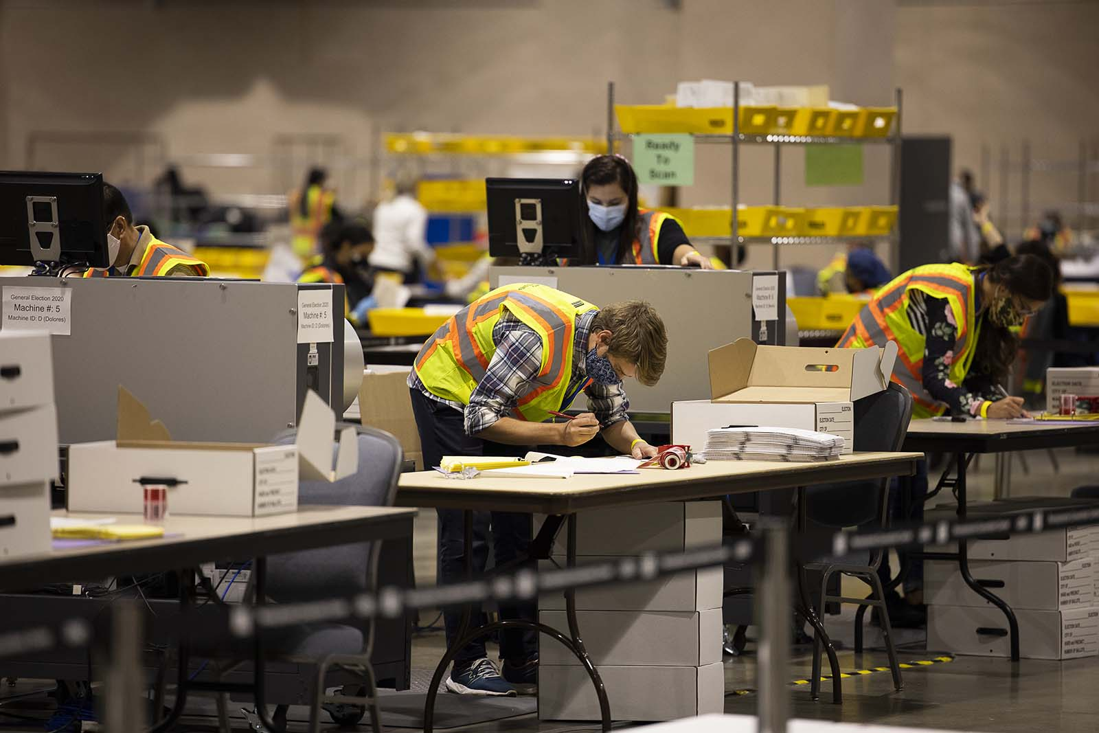 Temporary employees of the City Commissioner's office wearing protective masks count votes at a convention center for the 2020 Presidential election in Philadelphia, Pennsylvania, U.S., on Wednesday, Nov. 4, 2020. Pennsylvania has more than 1 million votes left to count, said its Governor Tom Wolf in a Twitter posting early Wednesday morning. Photographer: Ryan Collerd/Bloomberg via Getty Images