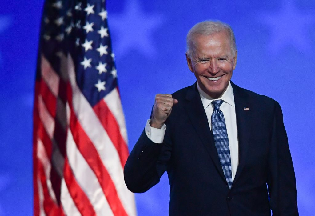 """TOPSHOT - Democratic presidential nominee Joe Biden gestures after speaking during election night at the Chase Center in Wilmington, Delaware, early on November 4, 2020. - Democrat Joe Biden said early Wednesday he believes he is """"on track"""" to defeating US President Donald Trump, and called for Americans to have patience with vote-counting as several swing states remain up in the air. """"We believe we are on track to win this election,"""" Biden told supporters in nationally broadcast remarks delivered in his home city of Wilmington, Delaware, adding: """"It ain't over until every vote is counted."""" (Photo by ANGELA WEISS / AFP) (Photo by ANGELA WEISS/AFP via Getty Images)"""