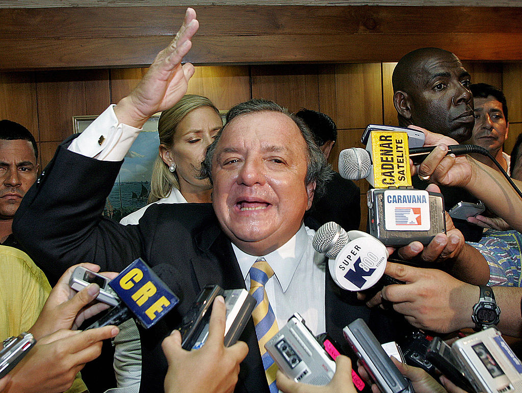 """Alvaro Noboa Guayaquil, ECUADOR: Ecuadorean presidential candidate and banana magnate Alvaro Noboa gestures during a press conference 26 November, 2006, in Guayaquil, province of Guayas, during general elections. Noboa on Sunday dismissed exit polls showing his leftist rival, Rafael Correa, won Ecuador's run-off presidential election. Asked if he would recognize the official outcome if it confirms his rival's victory, Noboa said: """"Once everything is cleared up and if I am convinced, I will recognize it, otherwise, I won't recognize it"""". AFP PHOTO/Mauricio DUENAS (Photo credit should read MAURICIO DUENAS/AFP via Getty Images)"""