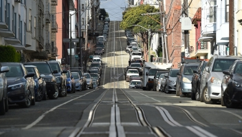 Washington Street, usually filled with iconic cable cars, is seen mostly empty in San Francisco, California on March 17, 2020. - Millions of San Francisco area residents last Monday were ordered to stay home to slow the spread of the deadly coronavirus as part of a lockdown effort covering a section of California including Silicon Valley. (Photo by Josh Edelson / AFP) (Photo by JOSH EDELSON/AFP via Getty Images)
