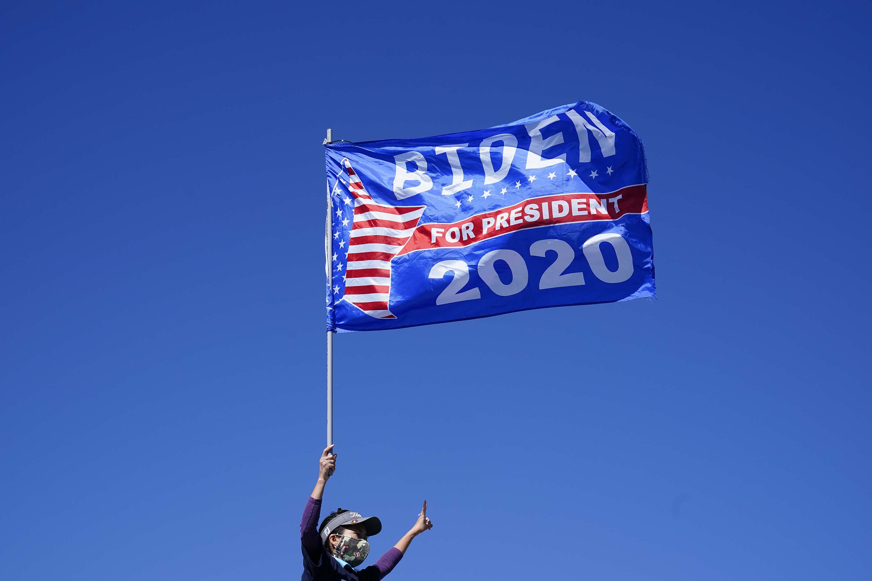 Biden supporters wait for former President Barack Obama to arrive and speak at a rally as he campaigns for Democratic presidential candidate former Vice President Joe Biden, Monday, Nov. 2, 2020, at Turner Field in Atlanta. (AP Photo/Brynn Anderson)