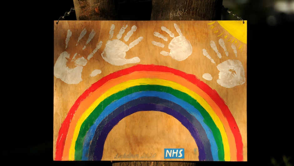 FARNHAM, ENGLAND - MAY 05: A homemade rainbow sign shows support for the NHS outside Dares Farm on May 05, 2020 in Farnham, England. The country continued quarantine measures intended to curb the spread of Covid-19, but the infection rate is falling, and government officials are discussing the terms under which it would ease the lockdown. (Photo by Alex Burstow/Getty Images)