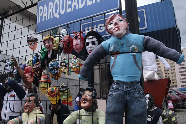 Picture taken during Ecuador's traditional New Year custom of burning dummies representing prominent politicians, sport personalities and artists in the belief that it brings good luck for the following year, in Quito on December 31, 2014. AFP PHOTO / JUAN CEVALLOS (Photo credit should read JUAN CEVALLOS/AFP via Getty Images)