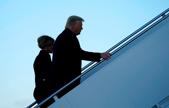 US President Donald Trump and First Lady Melania Trump board Air Force One at Joint Base Andrews in Maryland on January 20, 2021. - President Trump travels to his Mar-a-Lago golf club residence in Palm Beach, Florida, and will not attend the inauguration for President-elect Joe Biden. (Photo by ALEX EDELMAN / AFP) (Photo by ALEX EDELMAN/AFP via Getty Images)