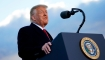 US President Donald Trump speaks before boarding Air Force One at Joint Base Andrews in Maryland on January 20, 2021. - President Trump travels to his Mar-a-Lago golf club residence in Palm Beach, Florida, and will not attend the inauguration for President-elect Joe Biden. (Photo by ALEX EDELMAN / AFP) (Photo by ALEX EDELMAN/AFP via Getty Images)