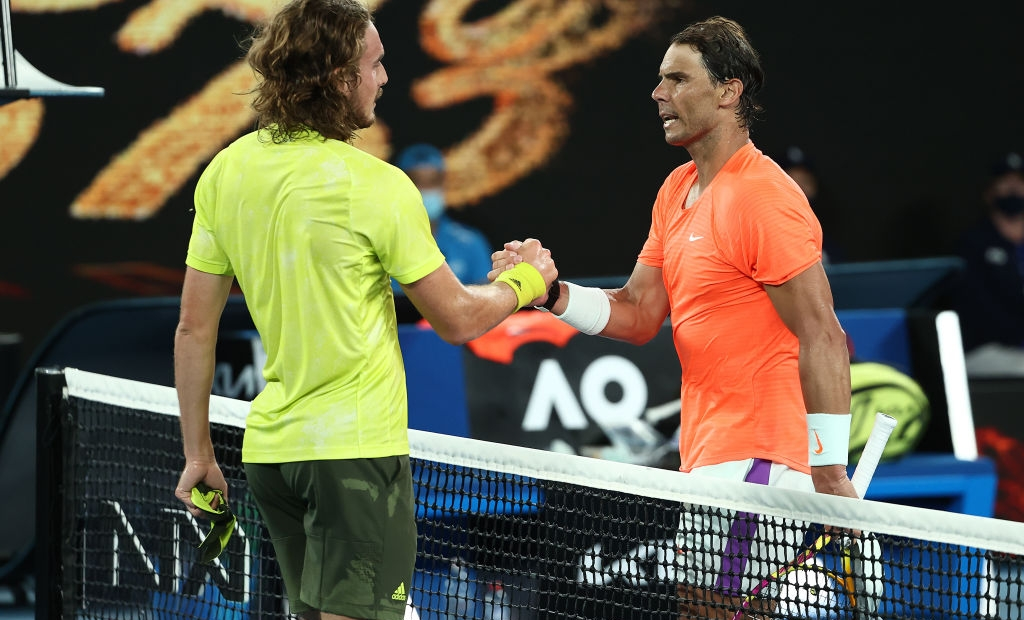 Tsitsipas Nadal MELBOURNE, AUSTRALIA - FEBRUARY 17: Stefanos Tsitsipas of Greece (L) embraces Rafael Nadal of Spain following victory in his Men's Singles Quarterfinals match during day 10 of the 2021 Australian Open at Melbourne Park on February 17, 2021 in Melbourne, Australia. (Photo by Cameron Spencer/Getty Images)