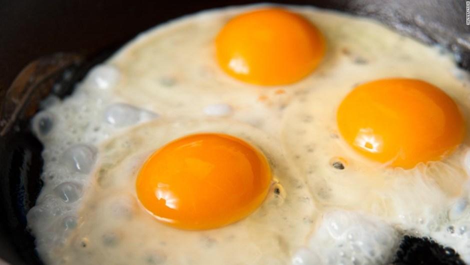 three fried eggs stock super tease