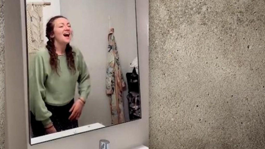 Mujer descubre un apartamento tras el espejo de su baño