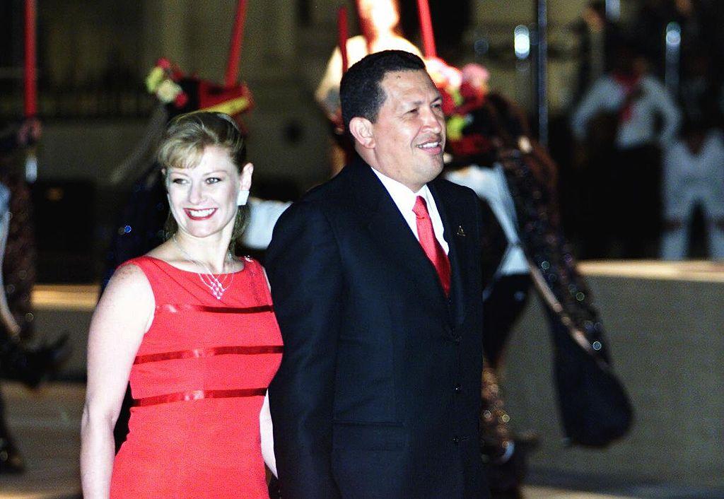 Hugo Chavez, president of Venezuela, arrives with his wife, Marisabel Rodriguez de Chavez, at the XI Ibero-american Summit, 23 November 2001 in Lima. Hugo Chavez, presidente de Venezuela, llega acompanado de su esposa Marisabel Rodriguez de Chavez, a la cena oficial de la XI Cumbre Iberoamericana, el 23 de noviembre de 2001 en Lima. AFP PHOTO/Alejandra BRUM (Photo credit should read ALEJANDRA BRUN/AFP via Getty Images)