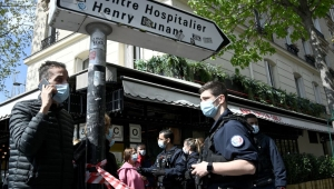 French police cordon off the area near the Henry Dunant private hospital where one person was shot dead and one injured in a shooting outside the instituion owned by the Red Cross in Paris' upmarket 16th district on April 12, 2021. (Photo by Anne-Christine POUJOULAT / AFP) (Photo by ANNE-CHRISTINE POUJOULAT/AFP via Getty Images)