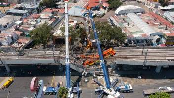 MEXICO CITY, MEXICO - MAY 04: Aerial view of the works to remove the damaged train after a train overpass collapsed last night killing 23 people on May 04, 2021 in Mexico City, Mexico. The accident happened between Olivos and Tezonco stations of metro line 12 at 10pm local time. (Photo by Hector Vivas/Getty Images)
