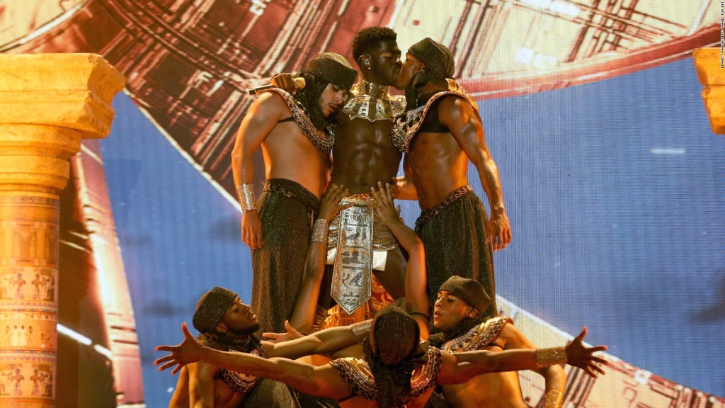 Lil Nas X kisses a dancer at the BET Awards