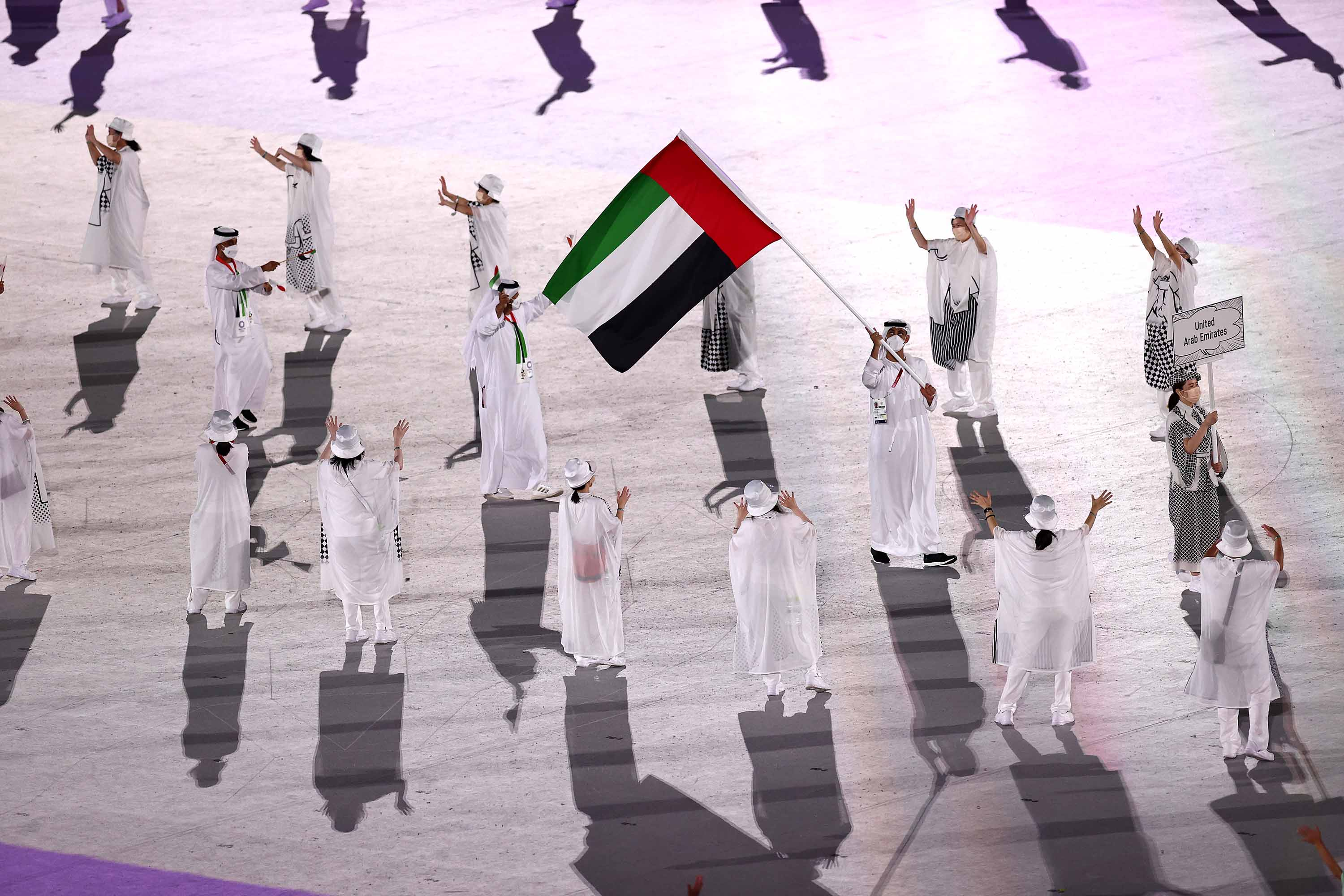 TOKYO, JAPAN - JULY 23: Flag bearer Yousuf Almatrooshi of Team United Arab Emirates during the Opening Ceremony of the Tokyo 2020 Olympic Games at Olympic Stadium on July 23, 2021 in Tokyo, Japan. (Photo by Maja Hitij/Getty Images)