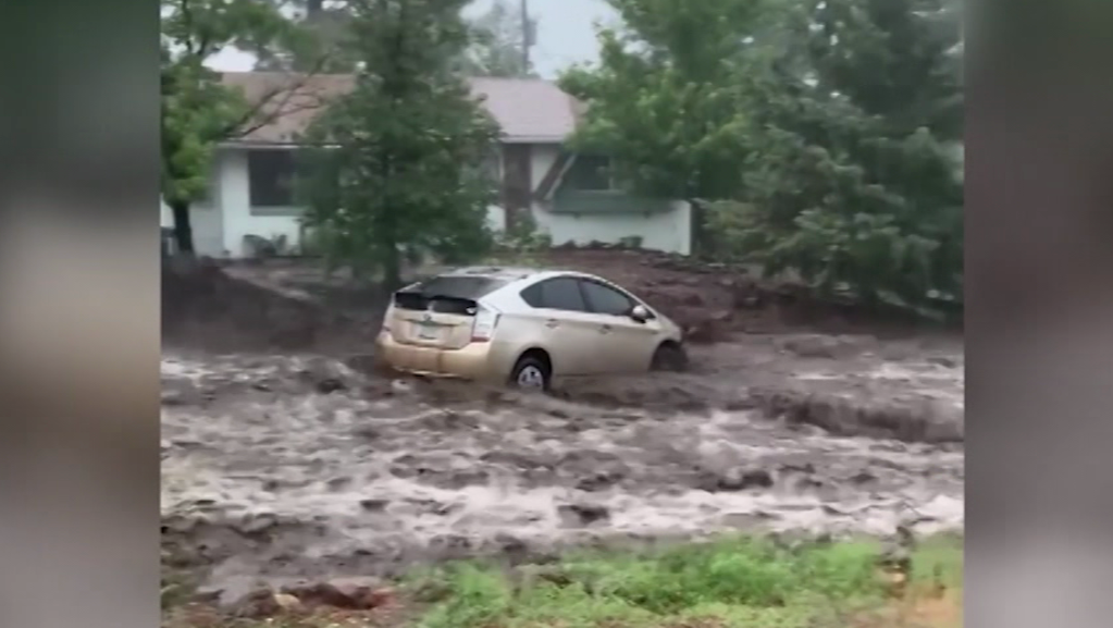 The moment a flood washes away a car