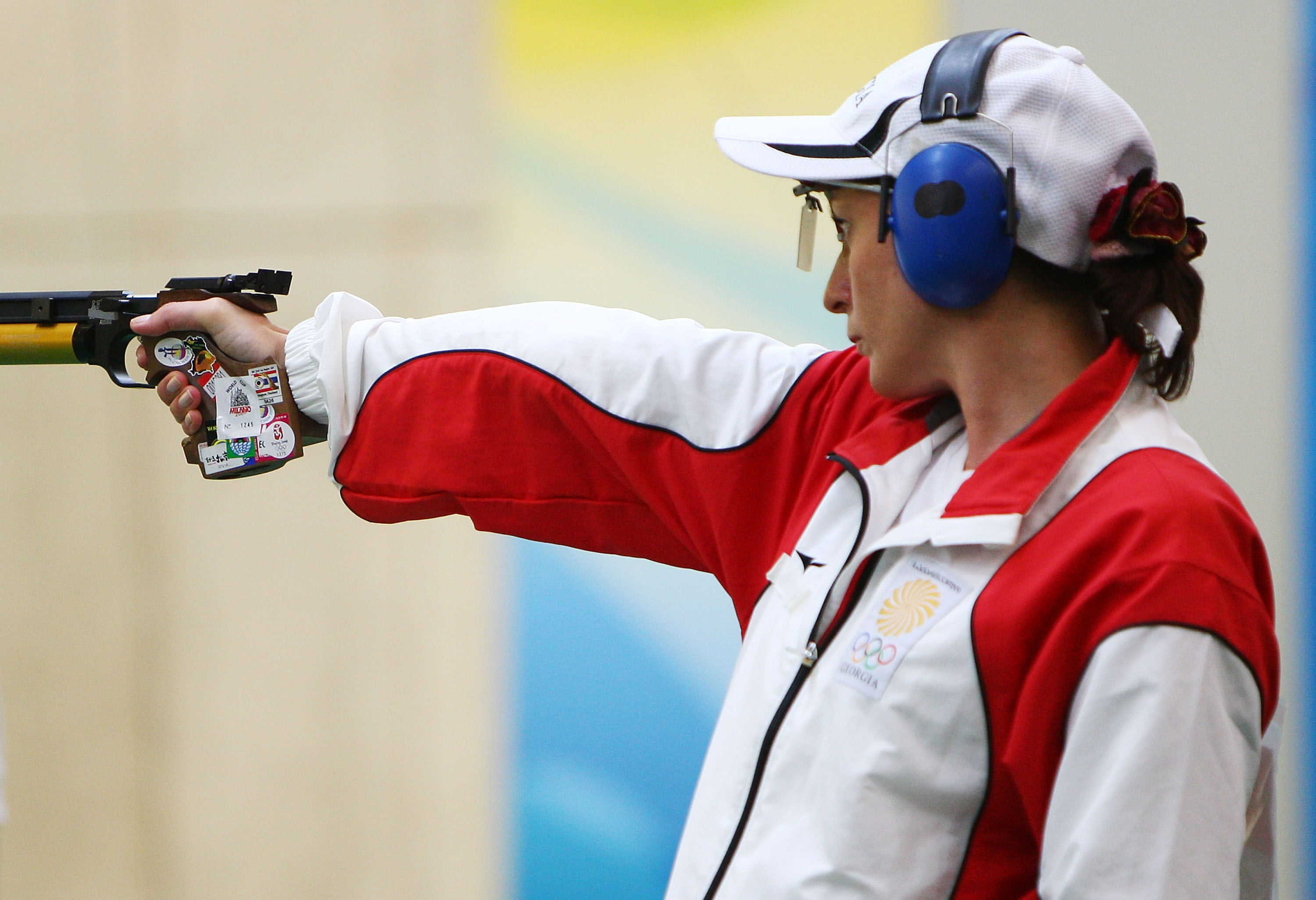BEIJING - AUGUST 10: Nino Salukvadze of Georgia competes in the women's 10m air pistol final shooting event held at the Beijing Shooting Range Hall during Day 2 of the 2008 Beijing Summer Olympic Games on August 10, 2008 in Beijing, China. Salukvadze finished third to win the bronze medal. (Photo by Clive Brunskill/Getty Images)