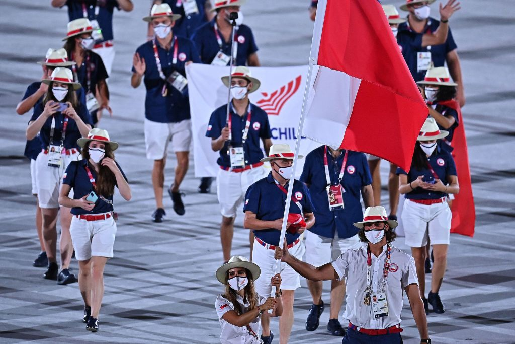 Chile's flag bearer Francisca Crovetto Chadid and Chile's flag bearer Marco Grimalt lead the delegation during the opening ceremony of the Tokyo 2020 Olympic Games, at the Olympic Stadium, in Tokyo, on July 23, 2021. (Photo by Ben STANSALL / AFP) (Photo by BEN STANSALL/AFP via Getty Images)