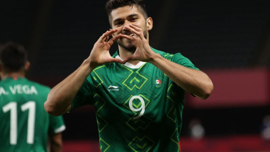 Mexico's forward Henry Martin reacts after he scores his team's third goal during the Tokyo 2020 Olympic Games men's group A first round football match between South Africa and Mexico at the Sapporo Dome in Sapporo on July 28, 2021. (Photo by ASANO IKKO / AFP) (Photo by ASANO IKKO/AFP via Getty Images)