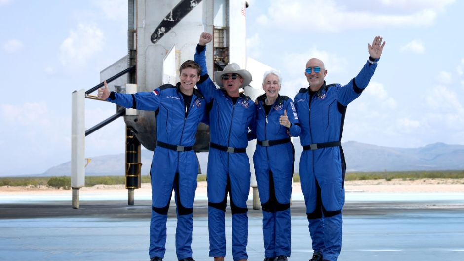 VAN HORN, TEXAS - JULY 20: Blue Origin's New Shepard crew (L-R) Oliver Daemen, Jeff Bezos, Wally Funk, and Mark Bezos pose for a picture after flying into space in the Blue Origin New Shepard on July 20, 2021 in Van Horn, Texas. Mr. Bezos and the crew that flew with him were the first human spaceflight for the company. (Photo by Joe Raedle/Getty Images)