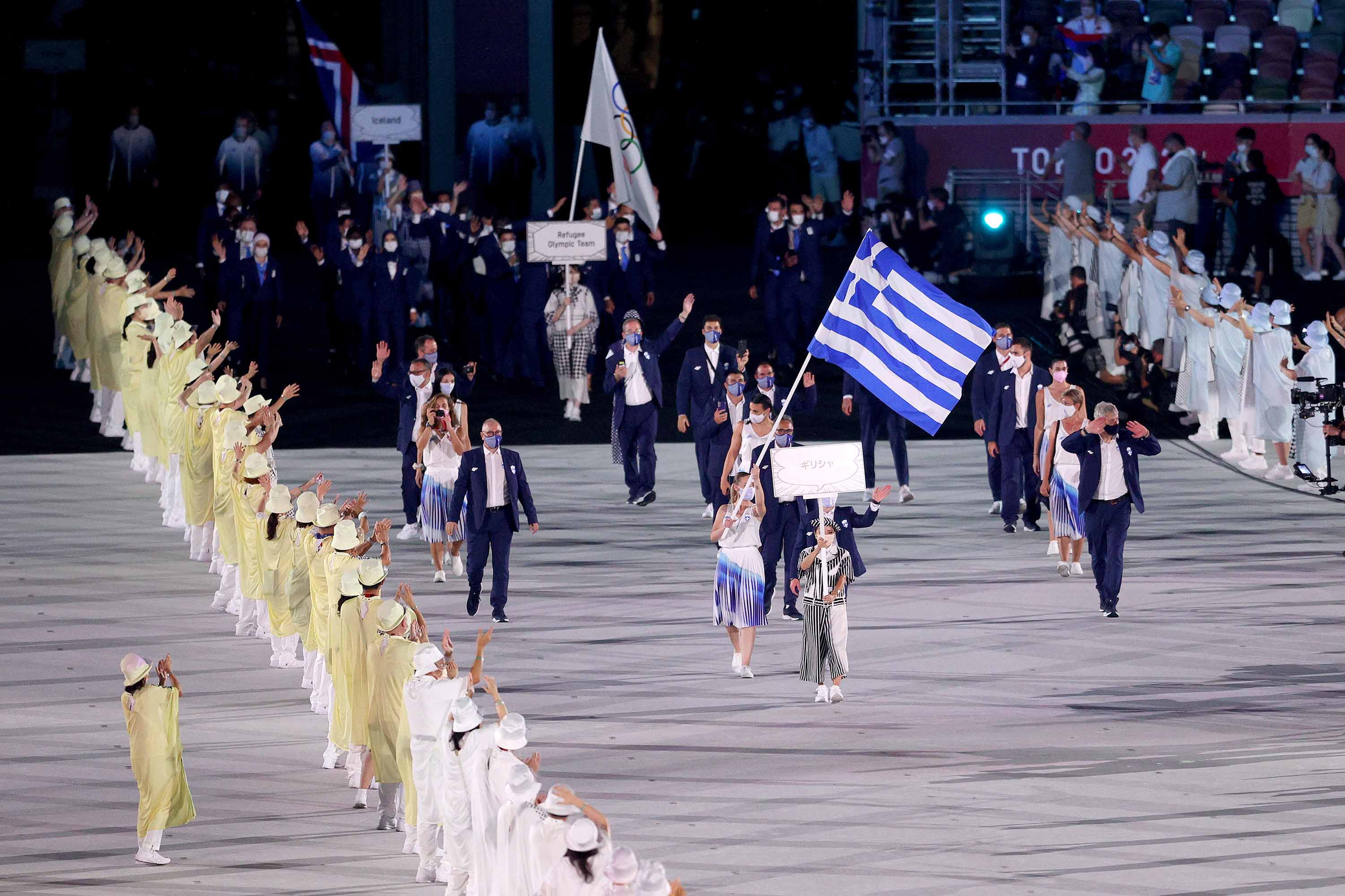 OKYO, JAPAN - JULY 23: Flag bearers Anna Korakaki and Eleftherios Petrounias of Team Greece lead their teammates out during the Opening Ceremony of the Tokyo 2020 Olympic Games at Olympic Stadium on July 23, 2021 in Tokyo, Japan. (Photo by Patrick Smith/Getty Images)