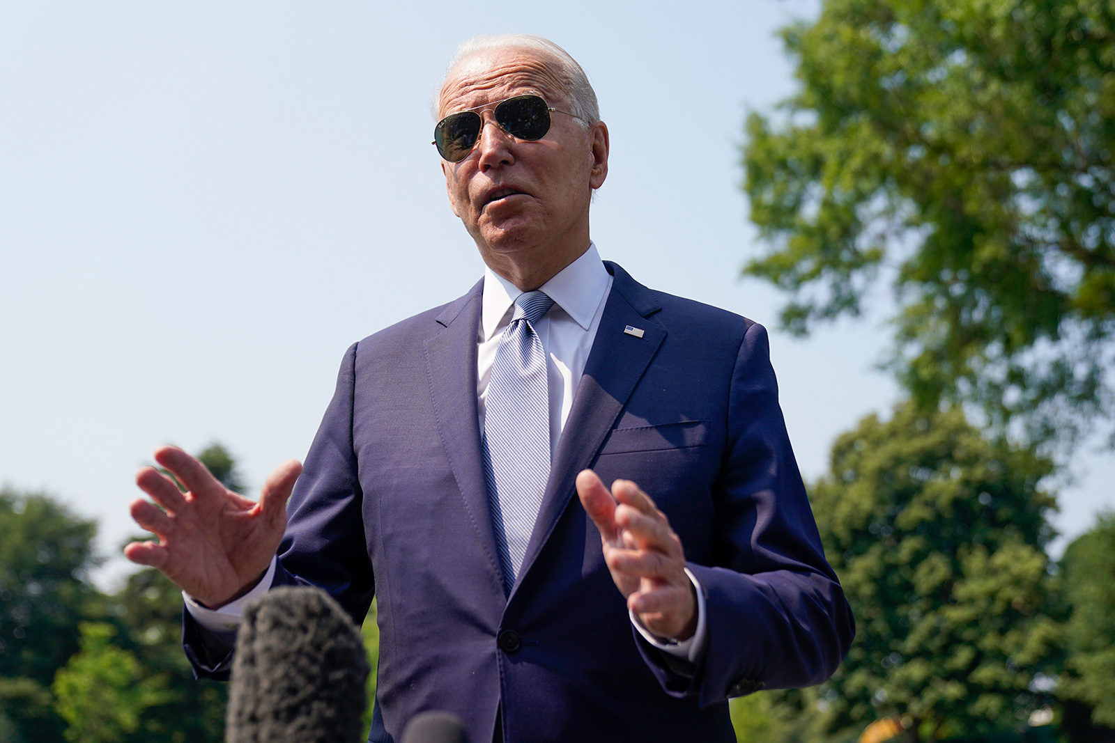 President Joe Biden talks to reporters before boarding Marine One on the South Lawn of the White House in Washington, Wednesday, July 7, 2021, for a short trip to Andrews Air Force Base, Md., and then on to Illinois. (AP Photo/Andrew Harnik)