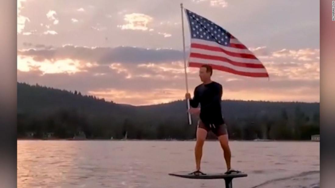 Zuckerberg publica un video ondeando la bandera de EE.UU. una tabla de surf eléctrica