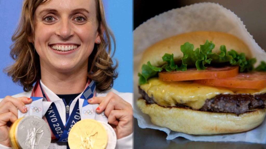 Atleta gana medalla de oro y lo celebra con hamburguesa