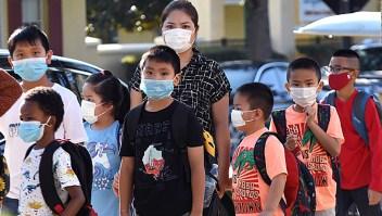 Escuelas desafían a Ron DeSantis por uso de mascarillas