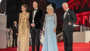 """Britain's Prince William, Duke of Cambridge (2L) and Britain's Catherine, Duchess of Cambridge (L) stand with Britain's Prince Charles, Prince of Wales (R) and Britain's Camilla, Duchess of Cornwall as they arrive for the World Premiere of the James Bond 007 film """"No Time to Die"""" at the Royal Albert Hall in west London on September 28, 2021. - Celebrities and royals walk the red carpet in central London on Tuesday for the star-studded but much-delayed world premiere of the latest James Bond film, """"No Time To Die"""". (Photo by Jack Hill / POOL / AFP) (Photo by JACK HILL/POOL/AFP via Getty Images)"""