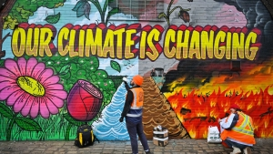 GLASGOW, SCOTLAND - OCTOBER 13: Artists paint a mural on a a wall next to the Clydeside Expressway near Scottish Events Centre (SEC) which will be hosting the COP26 UN Climate Summit later this month, on October 13, 2021 in Glasgow, Scotland. COP26 will officially begin on Sunday October 31 with the procedural opening of negotiations and finish on Monday November 12th. (Photo by Jeff J Mitchell/Getty Images)