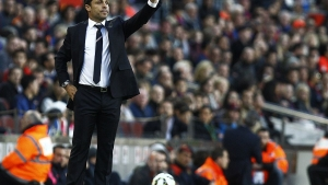Almeria's coach Sergi Barjuan gestures from the sidelines during the Spanish league football match FC Barcelona v UD Almeria at the Camp Nou stadium in Barcelona on April 8, 2015. AFP PHOTO / QUIQUE GARCIA (Photo credit should read QUIQUE GARCIA/AFP via Getty Images)